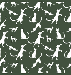 pattern of vintage cats against a dark background vector image