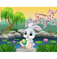 Carton happy Easter Bunny painting an egg vector image vector image