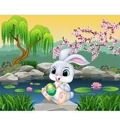 Carton happy easter bunny painting an egg vector
