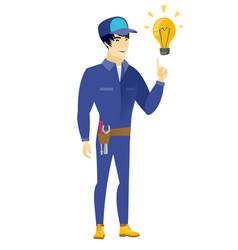 Mechanic pointing at bright idea light bulb vector