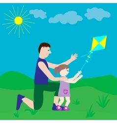 Dad and daughter playing with a kite vector