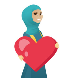 Young muslim business woman holding a big heart vector