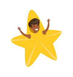Smiling little boy dressed as an yellow star vector