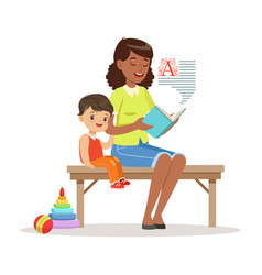 Teacher reading a book to little boy while sitting vector