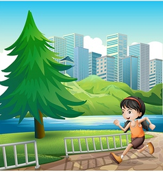 A young girl running at the riverbank vector image vector image