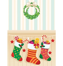 Christmas socks with gifts vector