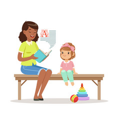 Teacher reading a book to little girl sitting on a vector