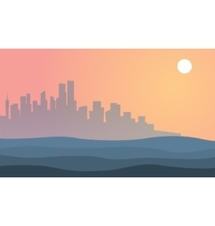 Silhouette of city town landscape at sunset vector