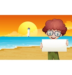 A boy at the beach holding an empty signage vector
