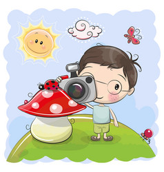 Cute cartoon boy with a camera vector