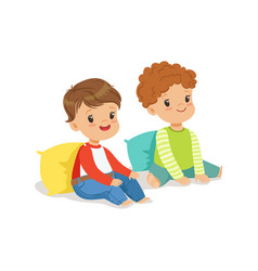 Two sweet smiling little boys sitting on the floor vector