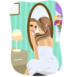 Young woman applying lipstick looking at mirror vector