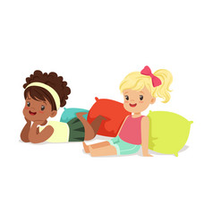 Two sweet little girls sitting and lying on the vector