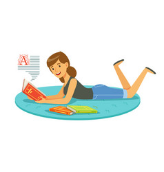 Beautiful woman reading a book while lying on her vector