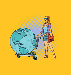 Woman tourist with a luggage cart with the planet vector