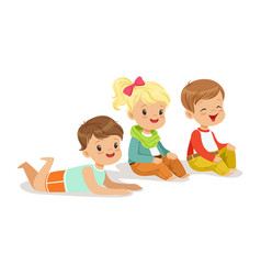 Sweet little kids sitting and lying on the floor vector