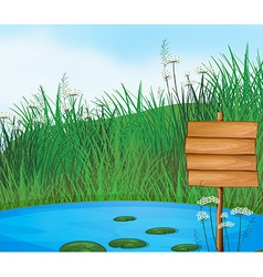 A pond with an empty signboard vector