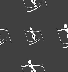 Skier icon sign seamless pattern on a gray vector