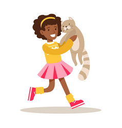 Happy girl holding a gray cat on her hands vector