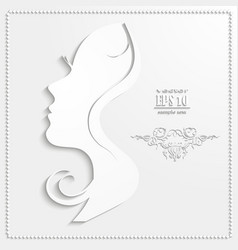 Profile of a beautiful woman cut out of paper vector image