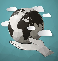 Paper planet earth in hand vector