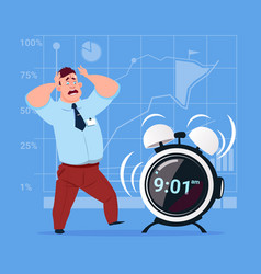 scared business man with alarm clock deadline time vector image