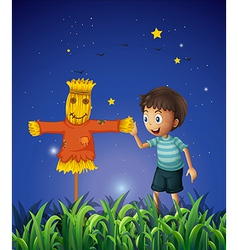 A boy and a scarecrow at the ricefield vector