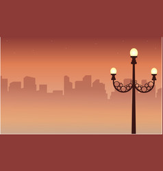 Street lamp scenery with city silhouettes vector