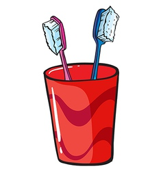 Toothbrush inside a red glass vector