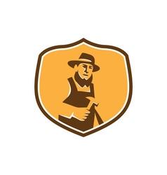 Amish carpenter holding hammer crest retro vector
