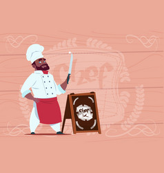 African american chef cook holding knife smiling vector