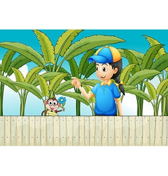 A girl and a monkey near the wooden fence vector image