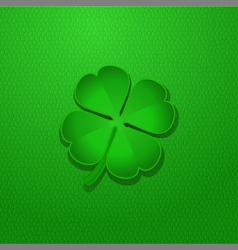 Shamrock on green leather vector