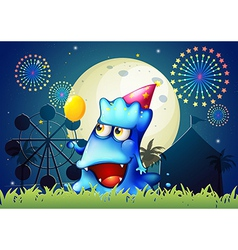 A monster at the carnival with a yellow balloon vector image