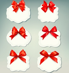 Set of beautiful retro labels with red gift bows vector