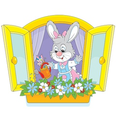 Easter bunny watering flowers vector
