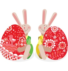 Two rabbits with easter eggs vector