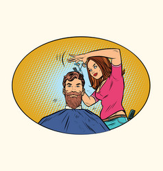 Woman hairdresser cuts the bearded hipster vector