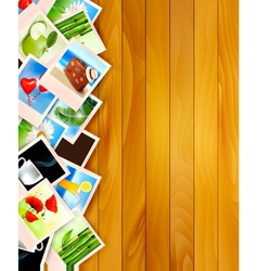 Colorful photos on wooden background vector
