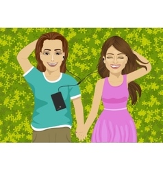 lovers lying on grass listening to music vector image vector image