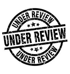 Under review round grunge black stamp vector