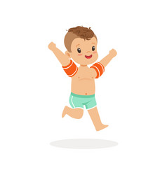 Cute happy boy running with inflatable armbands vector