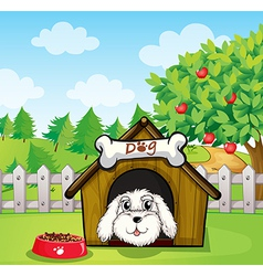 A puppy inside a doghouse near an apple tree vector