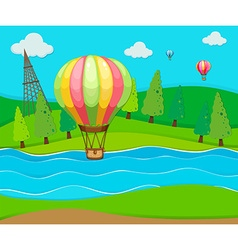 Balloons flying over the river vector