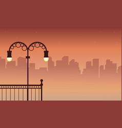 Silhouette of city street lamp scenery vector