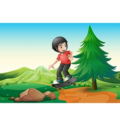 A young boy skateboarding at the hilltop vector image