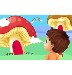 A young boy watching the giant mushroom houses vector image vector image