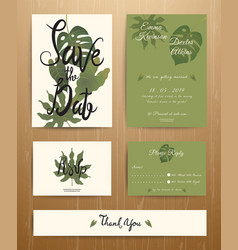 Tropical palm leaves wedding invitation card set vector