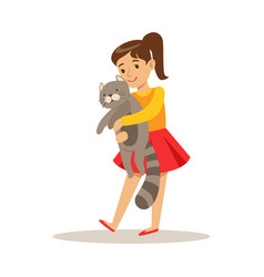 Cute girl holding a gray cat on her hands vector
