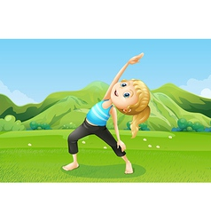 A girl exercising barefoot at the field vector